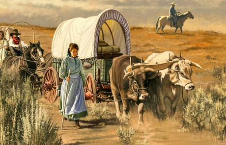 woman walking beside a wagon