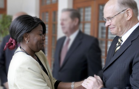 Dale G. Renlund shaking hands with woman