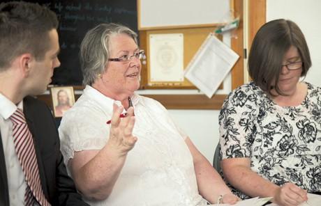 woman speaking in teacher council meeting