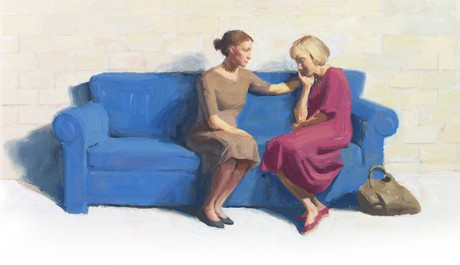 women sitting on couch