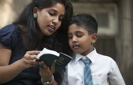 mother and son reading scriptures