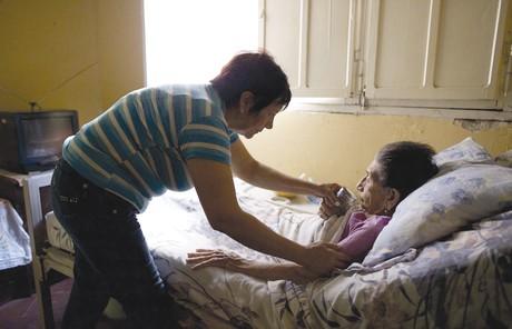 Serving a bed-ridden elderly woman