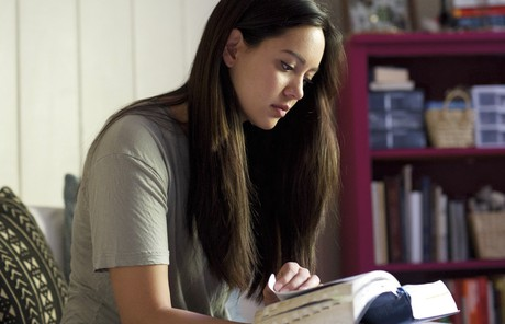 young woman reading her scriptures