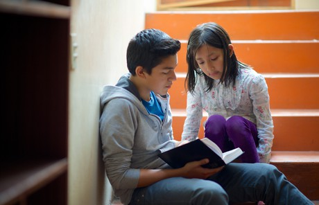 Youth reading the Book of Mormon