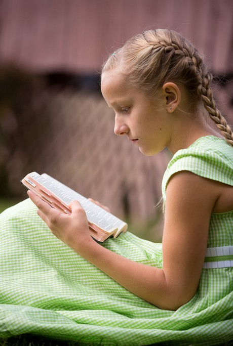 Child reading the Book of Mormon