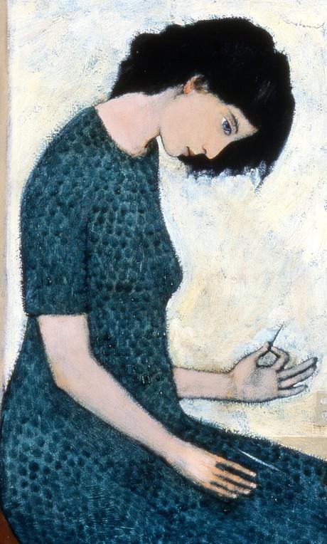 woman mending a tear