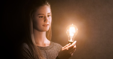 young woman holding lightbulb