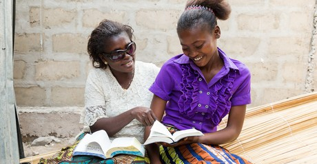 mother and daughter studying scriptures