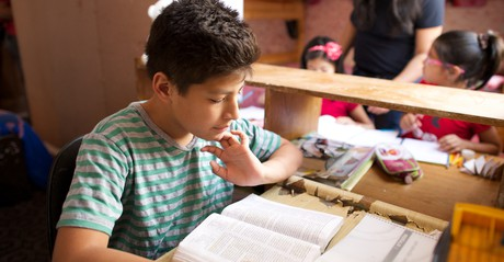 young man studying scriptures