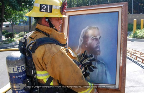 Firefighter with painting of the Savior