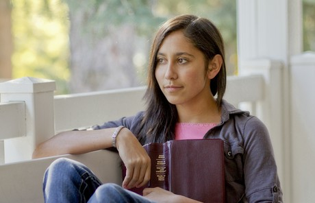 young woman holding scriptures