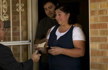 woman being given an invitation