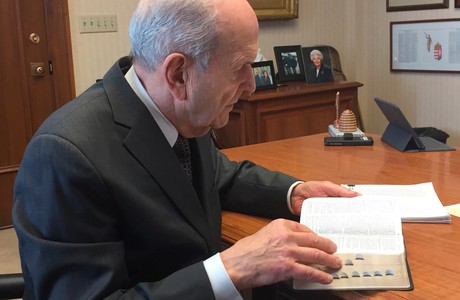 President Nelson studying the scriptures