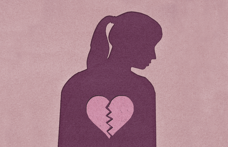 silhouette of woman with image of broken heart