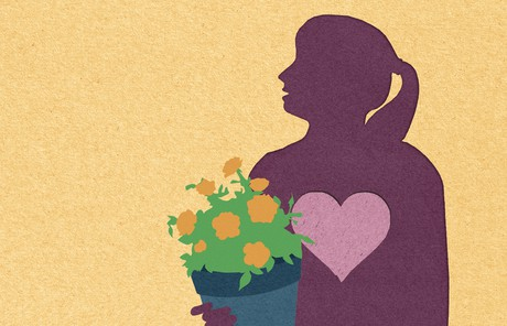silhouette of woman holding potted flowers