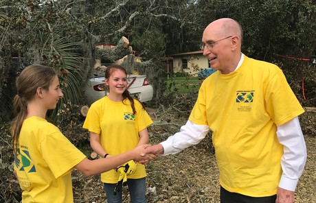 Young women with President Eyring