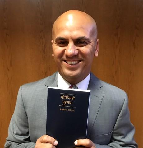Girish Ghimire with Nepali Book of Mormon