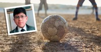 young man and soccer ball