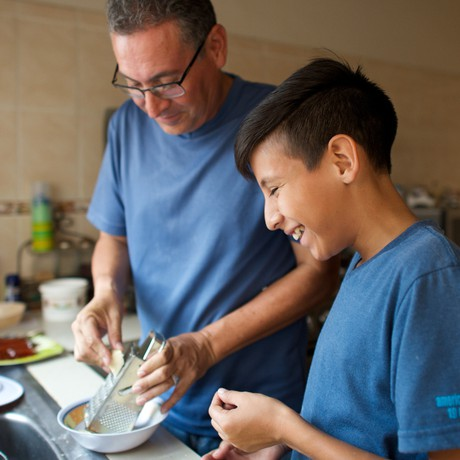 man and young man cooking