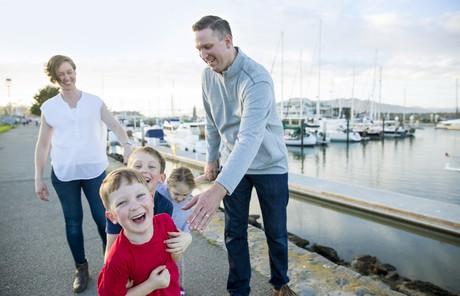 family walking near a harbor