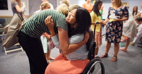 girls hugging at church
