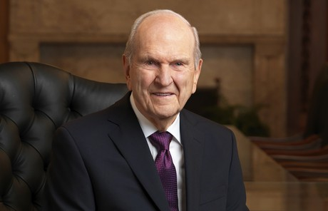 President Russell M. Nelson seated in black chair