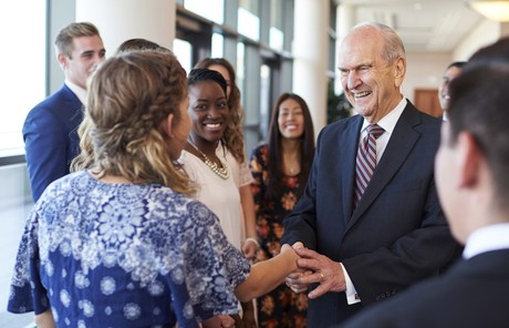 Russell M. Nelson with young adults