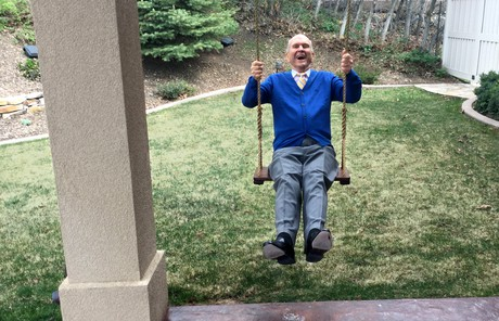 Russell M. Nelson on a swing