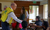 President Henry B. Eyring visiting with volunteers