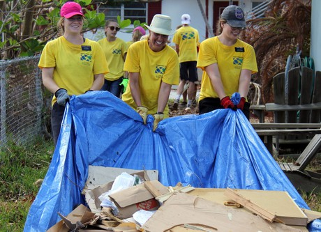 volunteers cleaning up debris