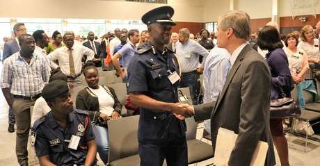 Elder David A. Bednar greeting chaplain general of Ghana police
