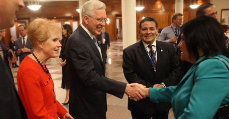 Elder D. Todd Christofferson shaking hands with woman at Conference Center