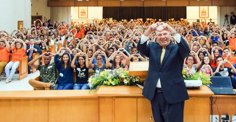 Elder Ronald A. Rasband making sign of heart at meeting in Brazil