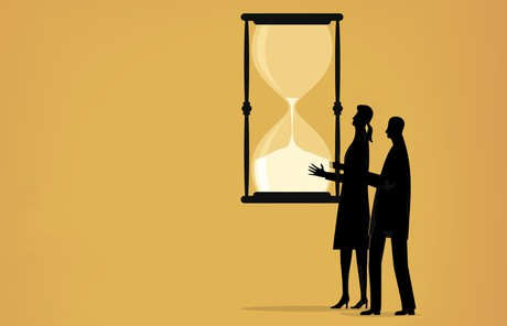 couple holding hourglass