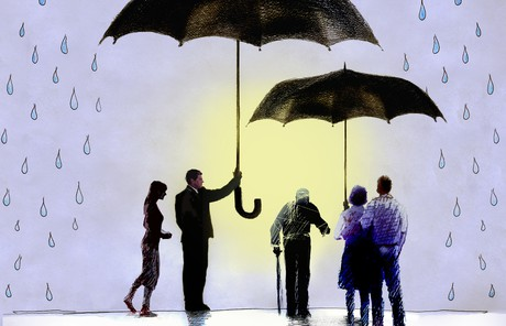 people standing under umbrellas