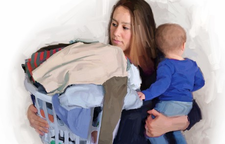 mother holding laundry basket and baby