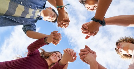 youth holding hands in a circle