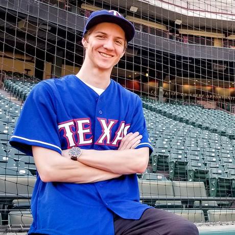 Young man at baseball stadium