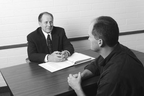 bishop interviewing man