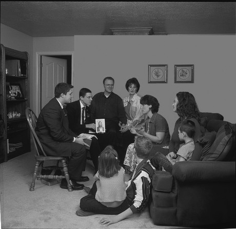 missionaries teaching family