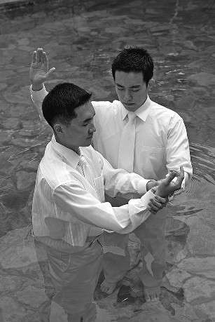 Young man being baptized