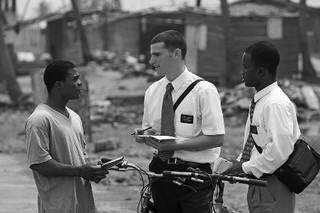 Missionaries talking to young man