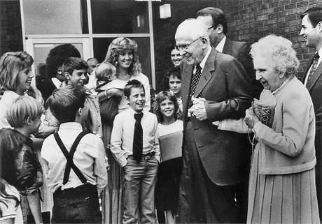 President and Sister Ezra Taft Benson in crowd of children