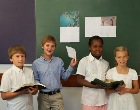 children reading scriptures