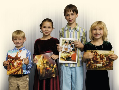 children holding pictures