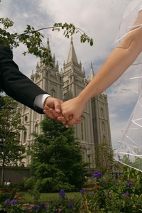 linked hands with Salt Lake Temple in background